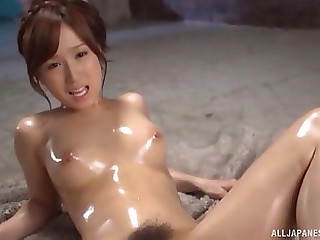 Oiled hottie Minami Kojima gets say no to cunt drilled with a fat dildo