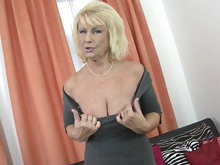 Blonde MILF Regina T. shows her tits before he fingers and fucks her