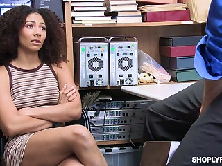 Guilty ebony gal Nia Nixon is fucked missionary on the table by cop