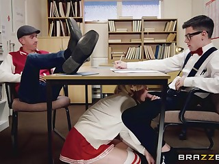 Blonde lies down on table to open three holes for the nerd
