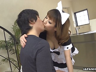 Naughty Japanese maid Yume Aino flashes boobies added to gives nice titjob