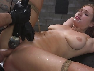 Skylar Snow is bounce with rope while her pussy is over-stimulated