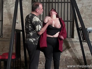 Obese red haired woman Emma gets punished nearby the BDSM room