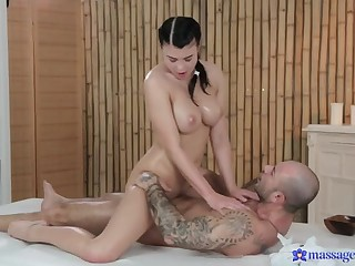 Rubbing the Tip of His Cock with Her Oiled-Up Tits