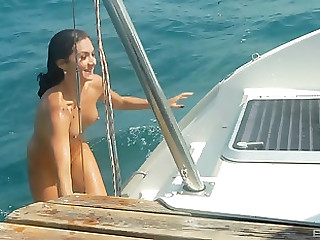 Julie Hunter coupled with her hot affiliate get their cunts fucked on the boat
