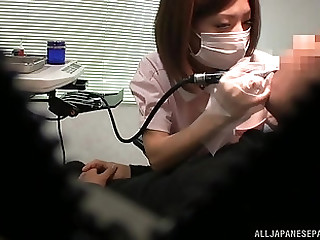 Asian nurse pleases a patient by jerking his stiff pecker